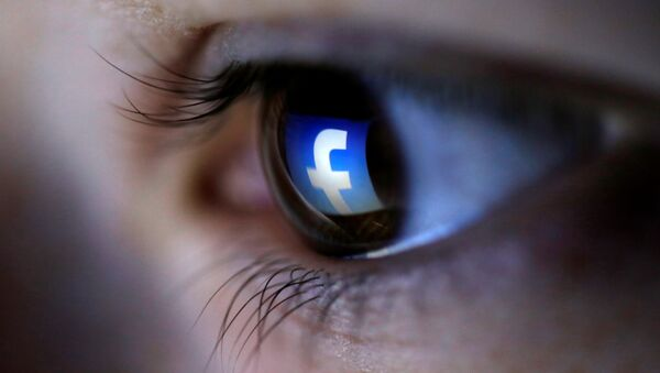 A picture illustration shows a Facebook logo reflected in a person's eye, in Zenica, March 13, 2015 - Sputnik International