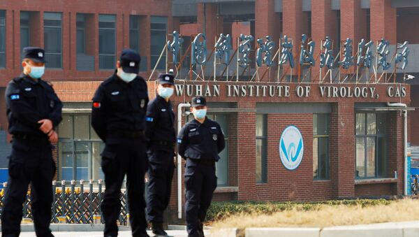 Security personnel keep watch outside Wuhan Institute of Virology during the visit by the World Health Organization (WHO) team tasked with investigating the origins of the coronavirus disease (COVID-19), in Wuhan, Hubei province, China February 3, 2021 - Sputnik International