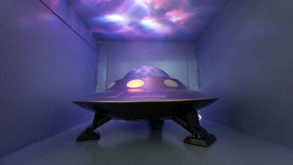 The Cosmic UFO, by Cloud b, that features moving projections of the Norther Lights, is demonstrated at the TTPM Holiday Showcase, in New York, Wednesday, Oct. 1, 2014. - Sputnik International