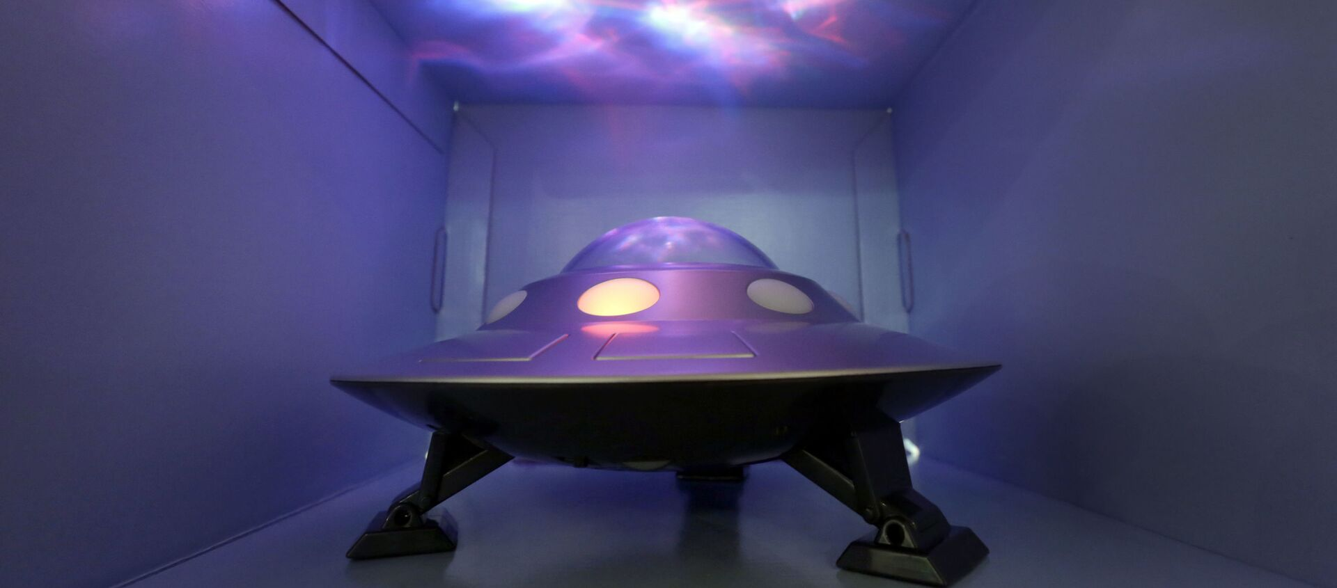 The Cosmic UFO, by Cloud b, that features moving projections of the Norther Lights, is demonstrated at the TTPM Holiday Showcase, in New York, Wednesday, Oct. 1, 2014. - Sputnik International, 1920, 06.07.2021