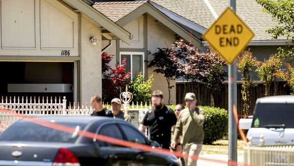 Emergency responders leave a home, rear, being investigated in connection to a shooting at a Santa Clara Valley Transportation Authority (VTA) facility, Wednesday, May 26, 2021, in San Jose, Calif. - Sputnik International