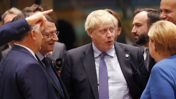 British Prime Minister Boris Johnson, center, speaks with Hungarian Prime Minister Viktor Orban, left, and German Chancellor Angela Merkel, right, during a round table meeting at an EU summit in Brussels, Thursday, Oct. 17, 2019. - Sputnik International