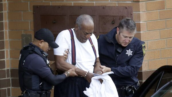 Bill Cosby is escorted out of the Montgomery County Correctional Facility, Tuesday Sept. 25, 2018, in Eagleville, Pa., following his sentencing to three-to-10-year prison sentence for sexual assault.  - Sputnik International