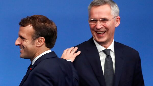 FILE PHOTO: French President Emmanuel Macron and NATO Secretary General Jens Stoltenberg react at a NATO summit meeting n Watford, Britain December 4, 2019. REUTERS/Christian Hartmann/Pool/File Photo - Sputnik International