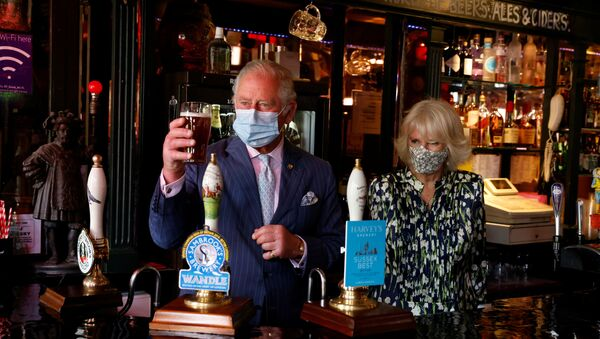 Britain's Prince Charles and Camilla, the Duchess of Cornwall visit Clapham Old Town in London, Britain, May 27, 2021. - Sputnik International