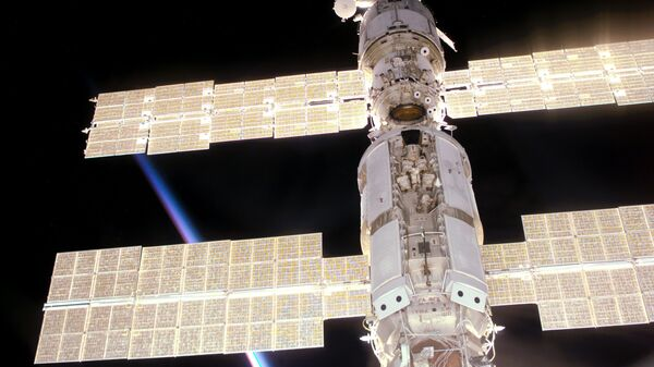 This photo provided by NASA shows the International Space Station as seen from Space Shuttle Atlantis during mission STS-106, which delivered supplies and performed maintenance in September 2000.  - Sputnik International