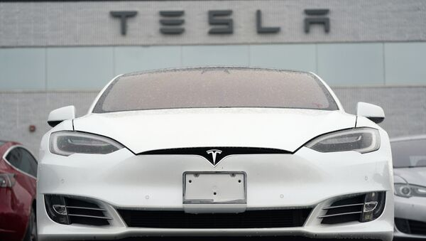 In this Sunday, 9 May 2021, photograph, an unsold S70 sedan sits at a Tesla dealership in Littleton, Colorado, US. - Sputnik International