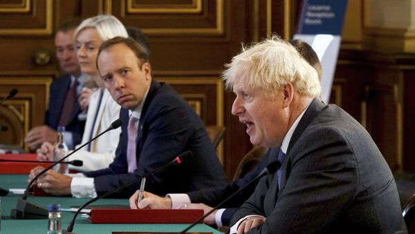 Britain's Prime Minister Boris Johnson, right, chairs a socially distanced government Cabinet meeting at the Foreign and Commonwealth Office (FCO) in London, Tuesday Sept. 15, 2020. - Sputnik International