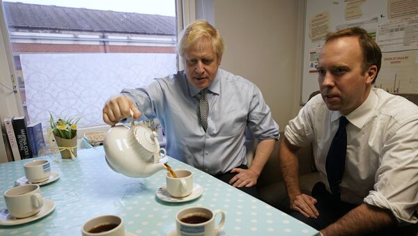 Secretary of State for Health and Social Care Matt Hancock, right, and Prime Minister Boris Johnson have tea with members of staff as they visit Bassetlaw District General Hospital, during their General Election campaign in Worksop, England, Friday, Nov. 22, 2019.  - Sputnik International
