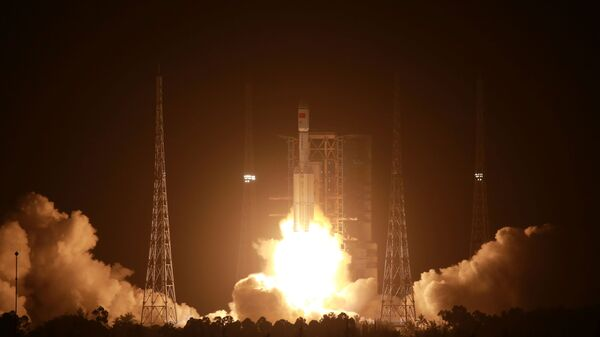 The Long March-7 Y3 rocket carrying the automated cargo resupply spacecraft Tianzhou-2 as one of the missions to complete China's space station, takes off from Wenchang Space Launch Center in Hainan province, China May 29, 2021.  - Sputnik International