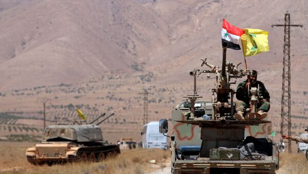 Hezbollah and Syrian flags flutter on a military vehicle in Western Qalamoun, Syria August 28, 2017. - Sputnik International