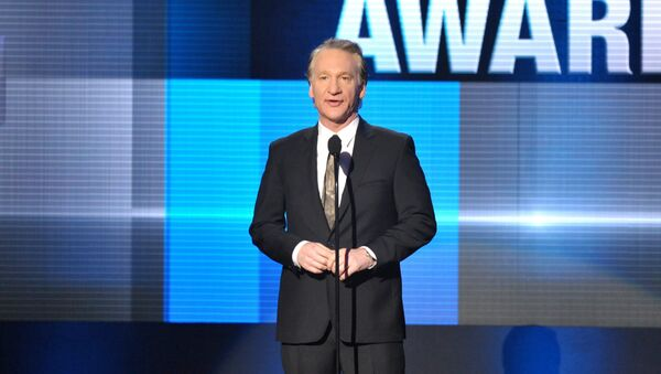 """FILE - In this 24 November 2013, file photo, Bill Maher presents the Icon award on stage at the American Music Awards at the Nokia Theatre L.A. Live in Los Angeles. """"Real Time"""" host Maher is taking on both conventions with special editions.  - Sputnik International"""