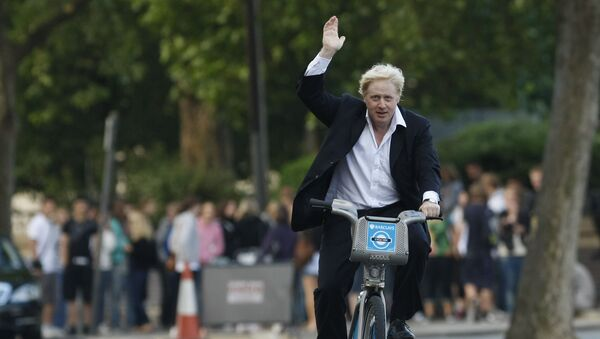 Boris Johnson Mayor of London waves to the media as he helps launch a new cycle hire scheme in London, Friday, July 30, 2010 - Sputnik International