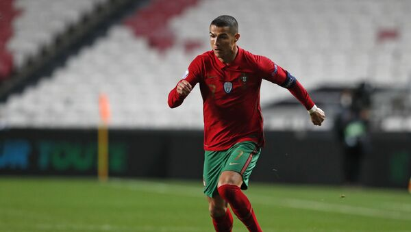 Portugal's Cristiano Ronaldo runs with the ball during the UEFA Nations League soccer match between Portugal and France at the Luz stadium in Lisbon, November 2020 - Sputnik International