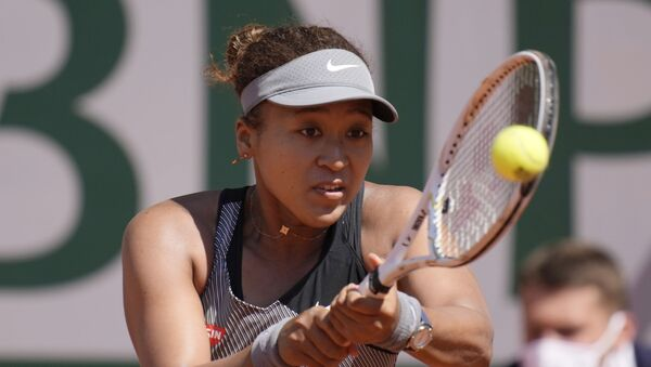 Japan's Naomi Osaka returns the ball to Romania's Patricia Maria Tig during their first round match of the French open tennis tournament at the Roland Garros stadium Sunday, 30 May 2021 in Paris.  - Sputnik International