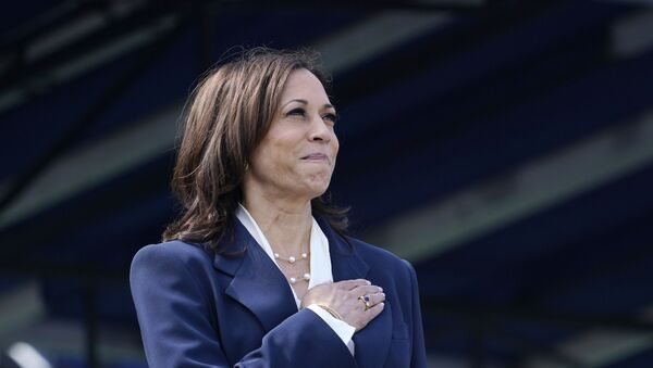 Vice President Kamala Harris stands during the National Anthem at the graduation and commissioning ceremony at the U.S. Naval Academy in Annapolis, Md., Friday, May 28, 2021 - Sputnik International