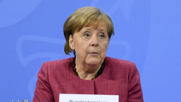 German Chancellor Angela Merkel attends a news conference at the Chancellery in Berlin, Germany May 27, 2021.  - Sputnik International