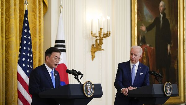 In this May 21, 2021, file photo, President Joe Biden listens as South Korean President Moon Jae-in speaks during a joint news conference in the East Room of the White House, in Washington. - Sputnik International