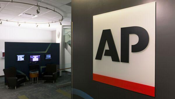 FILE - The Associated Press logo appears on April 26, 2016, in New York - Sputnik International