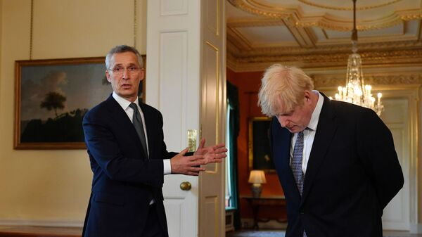 NATO Secretary-General Jens Stoltenberg gestures as he speaks next to Britain's Prime Minister Boris Johnson during a news conference following their meeting at Downing Street in London, Britain June 2, 2021.  - Sputnik International