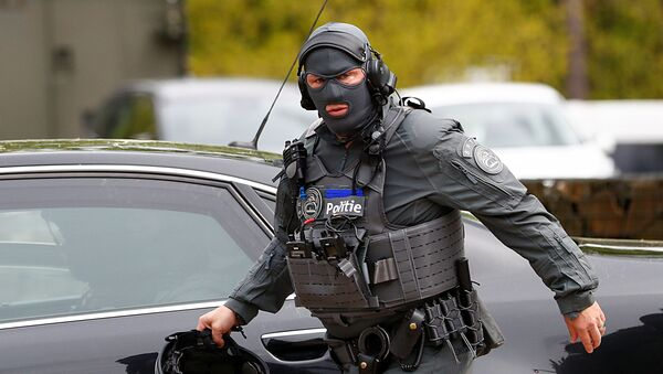 A member of the Belgian police is seen near the entrance of National Park Hoge Kempen while scouring to capture Belgian Jurgen Conings, a soldier who disappeared after threatening a virologist supportive of coronavirus disease (COVID-19) vaccines and coronavirus restrictions, in Maasmechelen, Belgium, 20 May 2021.  - Sputnik International
