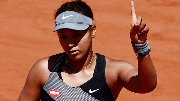 Tennis - French Open - Roland Garros, Paris, France - May 30, 2021 Picture taken May 30, 2021 Japan's Naomi Osaka reacts during her first round match against Romania's Patricia Maria Tig - Sputnik International