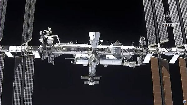This image made from NASA TV shows the international space station, seen from the SpaceX Crew Dragon spacecraft Saturday, April 24, 2021 - Sputnik International