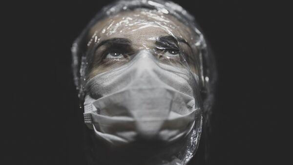 Portrait of a woman wearing mask - Sputnik International
