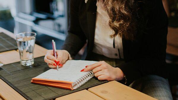 Closeup of woman studying at home - Sputnik International