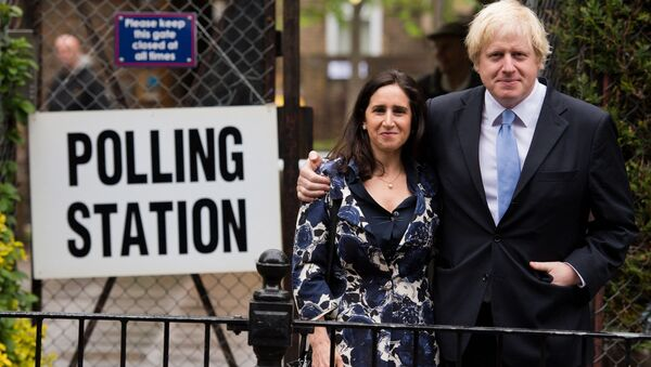 London Mayor Boris Johnson (R) stands with his wife Marina Wheeler (L) after casting his vote in the local elections - Sputnik International