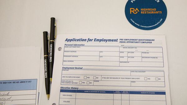 An employment application form is displayed during a restaurant job career fair organized by the industry group High Road Restaurants in New York City, U.S., May 13, 2021.  - Sputnik International