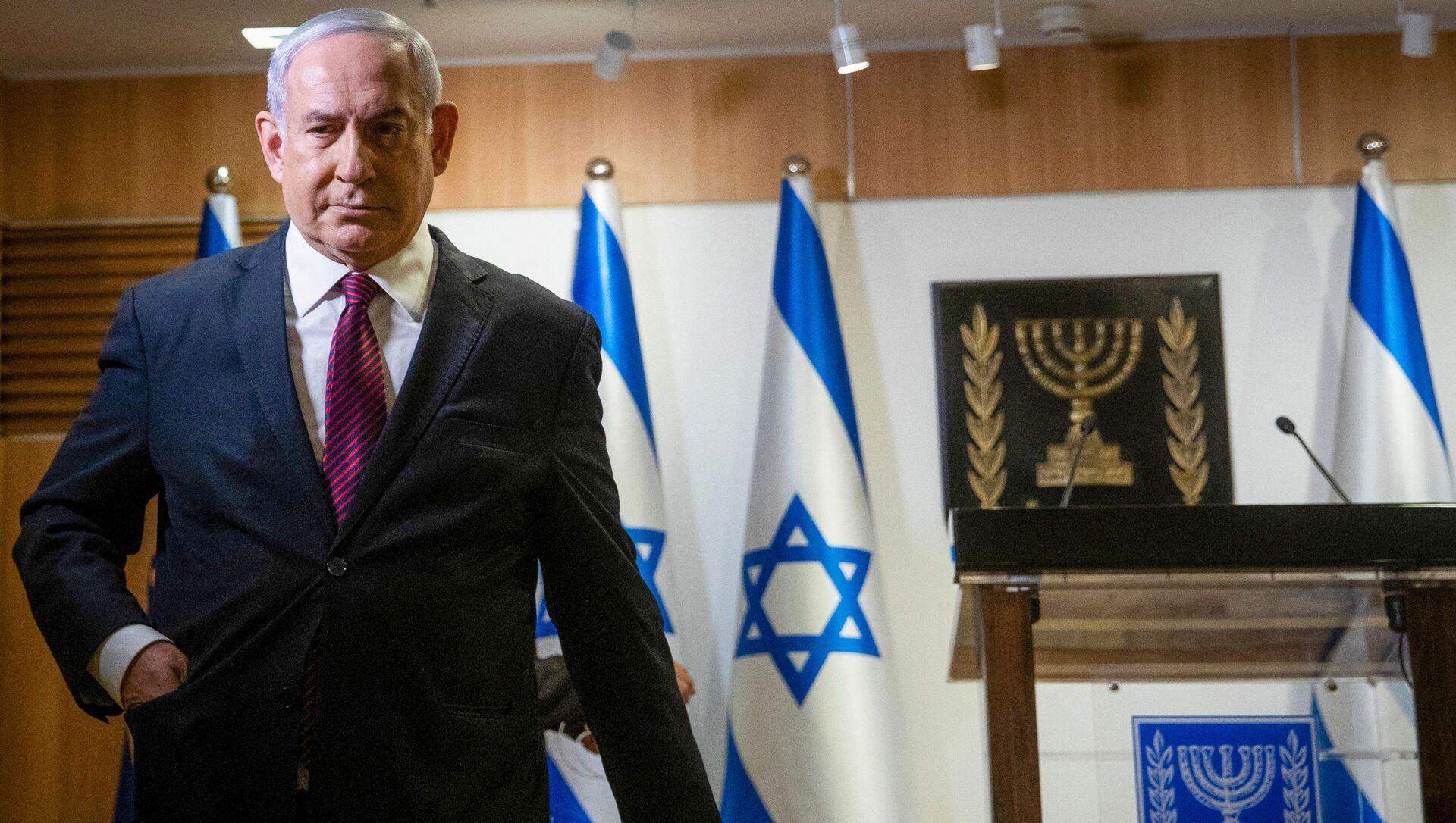 In this file photo taken on December 22, 2020 Israeli Prime Minister Benjamin Netanyahu leaves after a speech at the Knesset (Israeli Parliament) in Jerusalem - Sputnik International, 1920, 01.08.2021