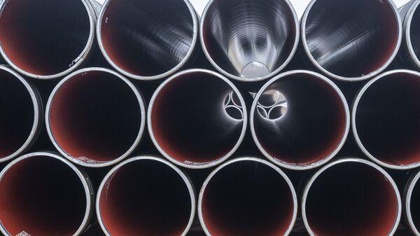 Pipes for the Baltic Pipe gas pipeline are stacked at Houstrup Strand, near Noerre Nebel, Jutland, Denmark, on February 23, 2021 - Sputnik International