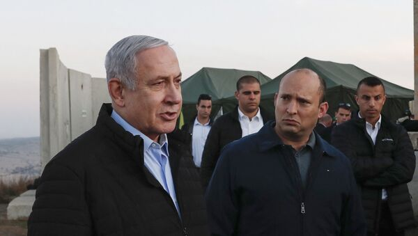Israel's Prime Minister Benjamin Netanyahu (L) and Defence Minister Naftali Bennett (2nd) visit an army base in the Israeli-annexed Golan Heights overlooking Syrian territory, on November 24, 2019.  - Sputnik International