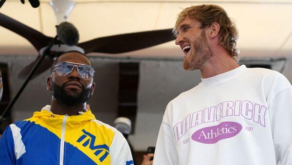 Jun 3, 2021; Miami Beach, Florida, USA; Professional boxer Floyd Mayweather Jr. and YouTube star Logan Paul face off at Villa Casa Casuarina - Sputnik International