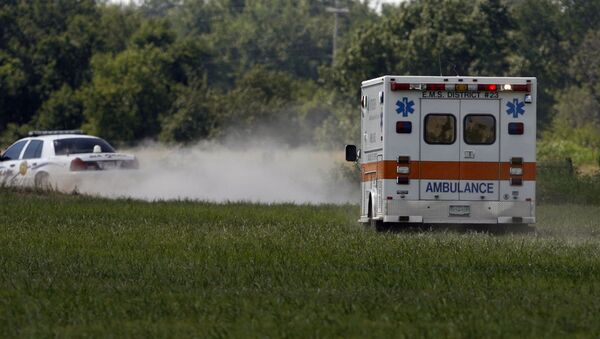 MIAMI, OK - JULY 23:  The ambulance carries thirty eight year old Trigger Gumm, who crashed while attempting a 315-foot motorcycle jump on a 450cc Service Honda outfitted with a custom-built 4-stroke engine at Buffalo Run Casino, July 23, 2006 in Miami, Oklahoma. If not for the crash, the jump would have been a world record with the length of more than a football field. After the crash, Gumm was able to walk to the medical car that transported him to a hospital for further evaluation. - Sputnik International