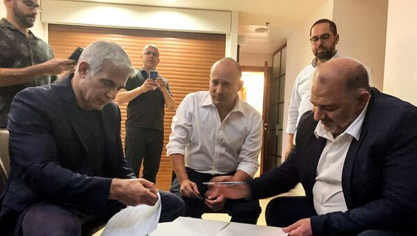 United Arab List party leader Mansour Abbas, Yamina party leader Naftali Bennett and Yesh Atid party leader Yair Lapid, sit together in Ramat Gan, near Tel Aviv, Israel June 2, 2021. Picture taken June 2, 2021 - Sputnik International