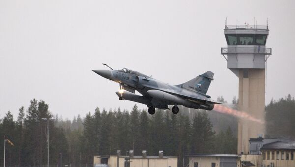 A French Mirage 2000 jet fighter takes off during the Arctic Challenge Exercise (ACE 2015) organized by Sweden, Finland and Norway in Rovaniemi, Finland on May 27, 2015.  - Sputnik International