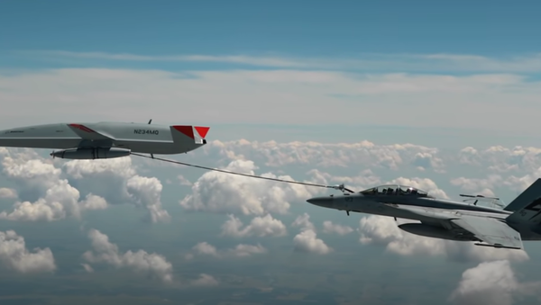 The MQ-25 T1 test asset has flown into the history books as the first unmanned aircraft to ever refuel another aircraft - piloted or autonomous - during flight. During this June 2021 flight test, the #MQ25 T1 test asset transferred fuel to an F/A-18 Super Hornet. After additional flight tests, this unmanned aerial refueling test asset will head to a U.S. Navy carrier for deck handling trials. - Sputnik International