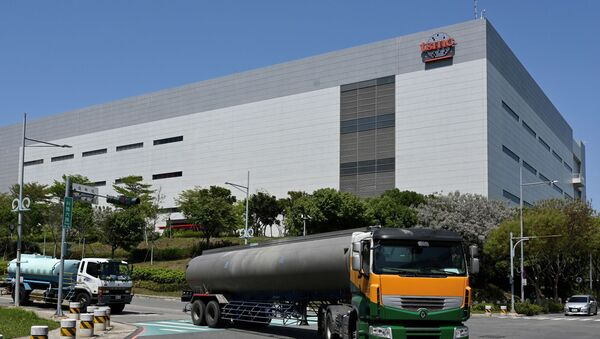 This photo taken on March 25, 2021 shows two water trucks passing a Taiwan Semiconductor Manufacturing Company (TSMC) factory in Taichung, central Taiwan. - Sputnik International