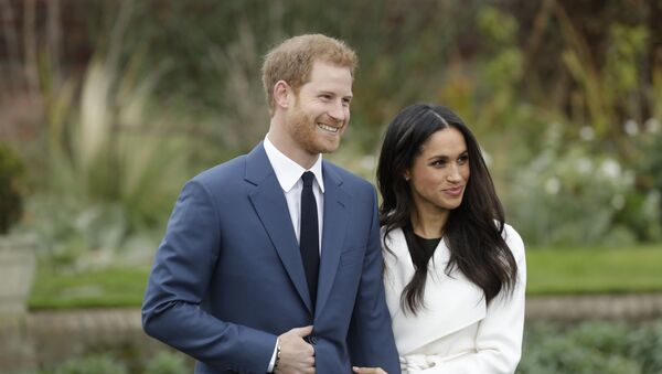 Britain's Prince Harry and his fiancee Meghan Markle pose for photographers during a photocall in the grounds of Kensington Palace in London, Monday Nov. 27, 2017 - Sputnik International