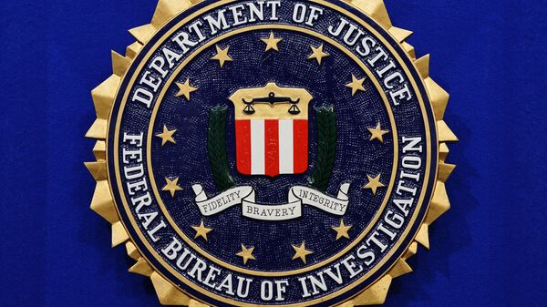 The Federal Bureau of Investigation (FBI) seal is seen on the lectern following a press conference announcing the FBI's 499th and 500th additions to the Ten Most Wanted Fugitives list on June 17, 2013 at the Newseum in Washington, DC.  - Sputnik International