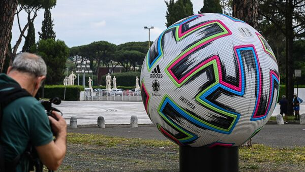 A video journalist films a giant football of the Euro 2020 European football tournament on 8 June 2021 by the Olympic stadium in Rome, three days before the delayed competition finally kicks off on June 11 in Rome when Italy hosts Turkey. - Sputnik International