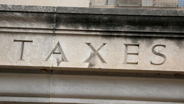 The word taxes is seen engraved at the headquarters of the Internal Revenue Service (IRS) in Washington, D.C., U.S., May 10, 2021. - Sputnik International
