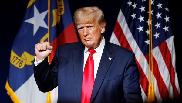 Former U.S. President Donald Trump makes a fist while reacting to applause after speaking at the North Carolina GOP convention dinner in Greenville, North Carolina, U.S. June 5, 2021. - Sputnik International