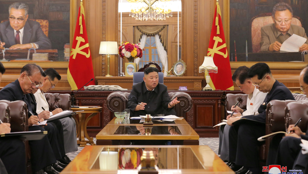KCNA image of North Korean leader Kim Jong Un at a meeting with senior officials from the Workers' Party of Korea (WPK) Central Committee and Provincial Party Committees in Pyongyang, June 8, 2021. - Sputnik International