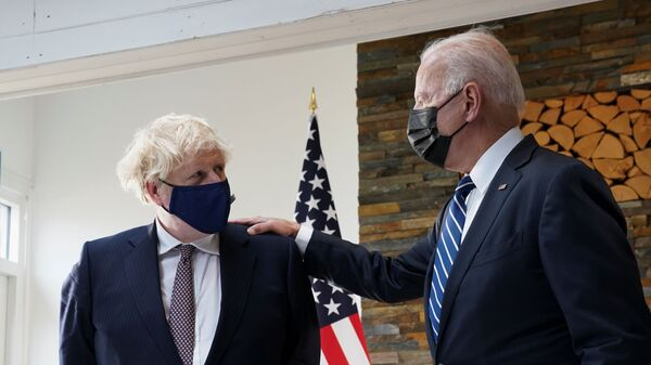 U.S. President Joe Biden speaks with Britain's Prime Minister Boris Johnson, as they look at historical documents and artefacts relating to the Atlantic Charter during their meeting, at Carbis Bay Hotel, Carbis Bay, Cornwall, Britain June 10, 2021  - Sputnik International