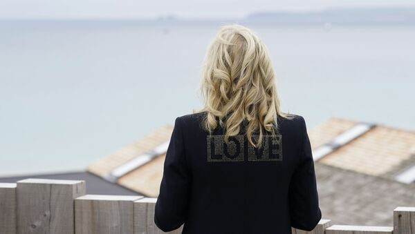 First lady Jill Biden turns around to show the word love on the back of her jacket as she speaks with reporters after visiting with Carrie Johnson, wife of British Prime Minister Boris Johnson, ahead of the G-7 summit, Thursday, June 10, 2021, in Carbis Bay, England. - Sputnik International