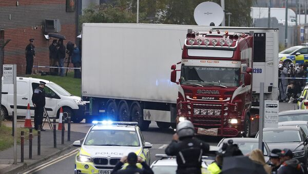 In this Wednesday Oct. 23, 2019 file photo, police escort the truck, that was found to contain a large number of dead bodies, as they move it from an industrial estate in Thurrock, south England - Sputnik International