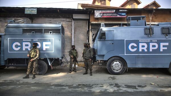 Indian Central Reserve Police Force (CRPF) soldiers guard during a gunfight between Indian government forces and suspected rebels in Srinagar, Indian controlled Kashmir, Monday, Oct. 12, 2020 - Sputnik International
